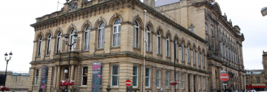An outdoor photograph of a traditional concert hall in Kirklees.