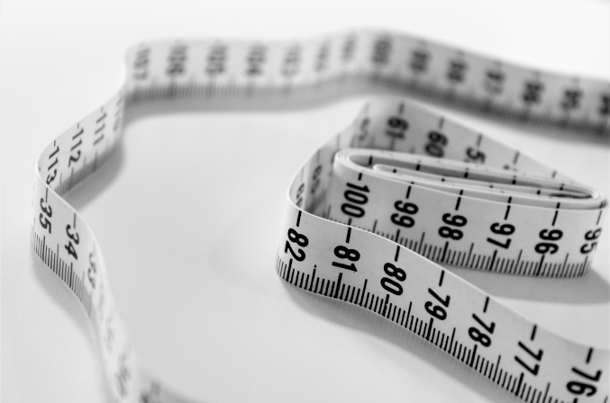A close up photo of a rolled up tape measure.
