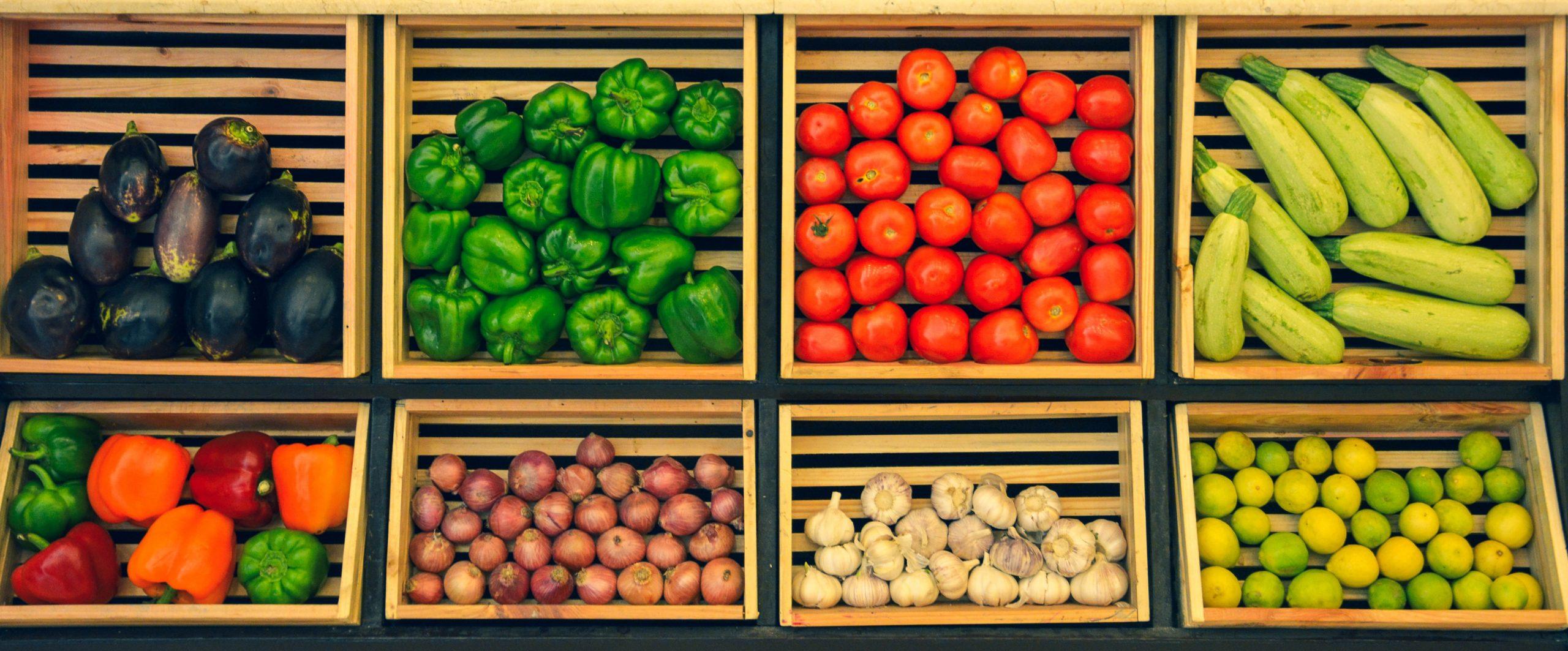 Fresh vegetables on shelving.