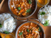 Two portions of delicious vegetable korma and rice.