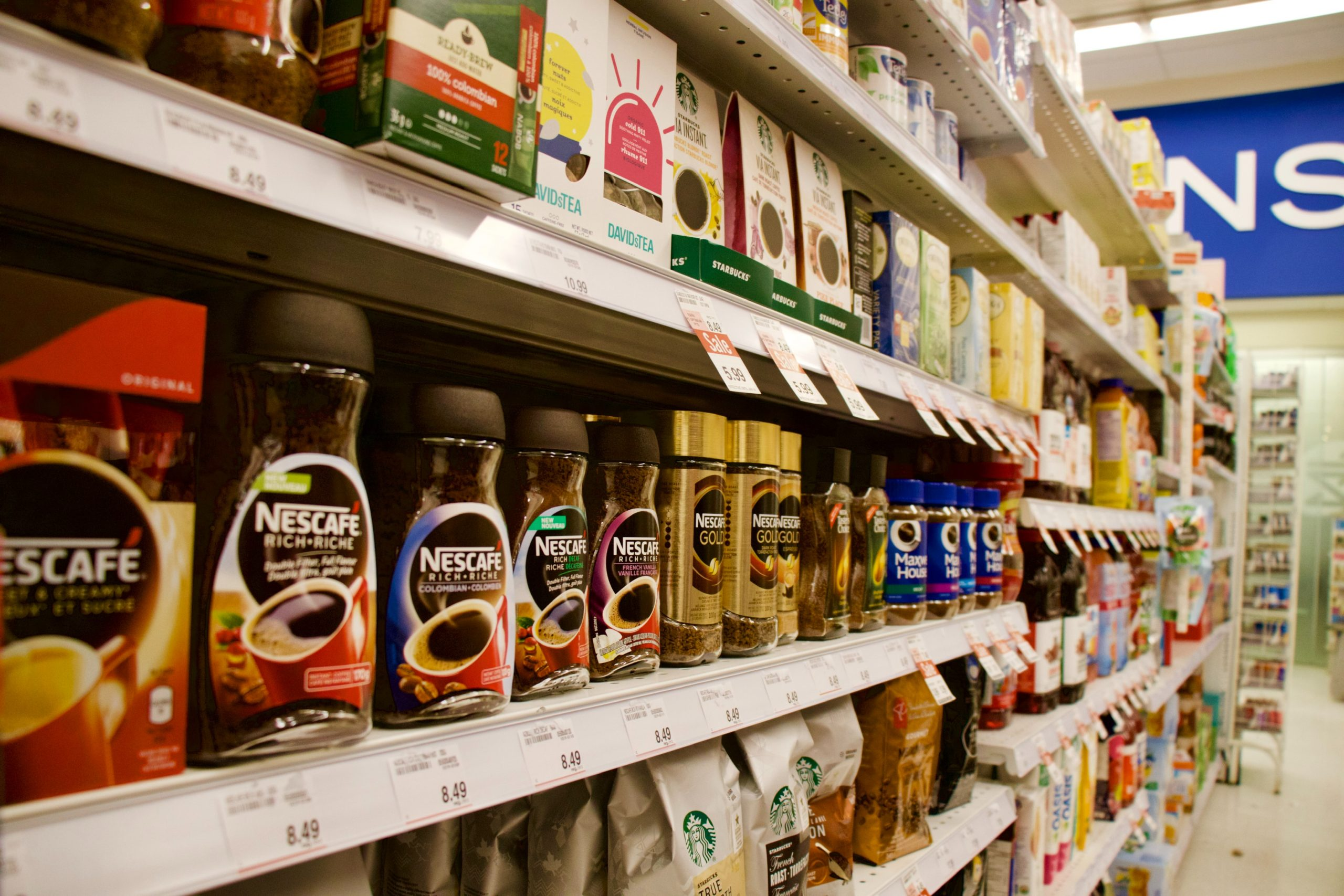 Supermarket shelves filled with products.